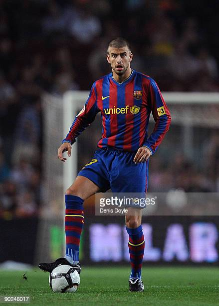 Gerard Pique of Barcelona in action during the La Liga match between Barcelona and Sporting Gijon at the Nou Camp stadium on August 31 2009 in...