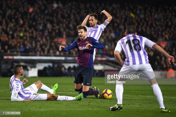 Gerard Pique of Barcelona is fouled by Michel of Real Valladolid leading to Barcelona being awarded a penalty during the La Liga match between FC...