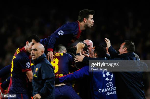 Gerard Pique of Barcelona jumps on his team mates as they celebrate Pedro of Barcelona scoring the equalising goal during the UEFA Champions League...