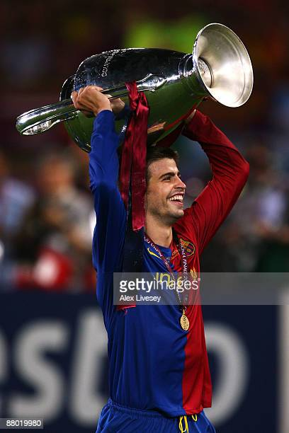 Gerard Pique of Barcelona lifts the trophy as he celebrates winning the UEFA Champions League Final match between Manchester United and Barcelona at...