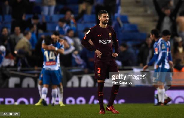 Gerard Pique of Barcelona looks dejected after Espanyol score their first goal during the Spanish Copa del Rey Quarter Final First Leg match between...