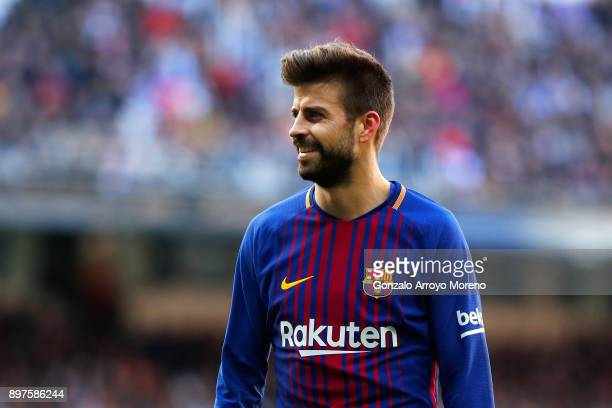 Gerard Pique of Barcelona looks on during the La Liga match between Real Madrid and Barcelona at Estadio Santiago Bernabeu on December 23 2017 in...
