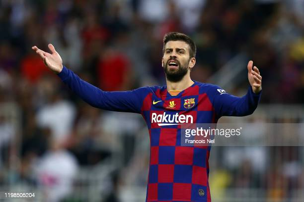 Gerard Pique of Barcelona reacts during the Supercopa de Espana Semi-Final match between FC Barcelona and Club Atletico de Madrid at King Abdullah...