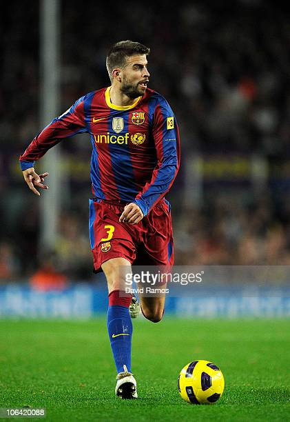 Gerard Pique of Barcelona runs with the ball during the La Liga match between Barcelona and Sevilla FC on October 30 2010 in Barcelona Spain...