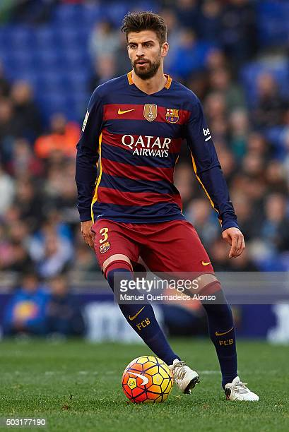 Gerard Pique of Barcelona runs with the ball during the La Liga match between Real CD Espanyol and FC Barcelona at CornellaEl Prat Stadium on January...