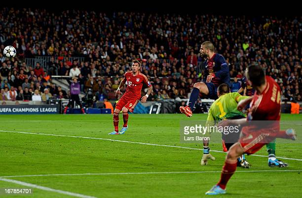 Gerard Pique of Barcelona scores an own goal to make the score 20 during the UEFA Champions League semi final second leg match between Barcelona and...