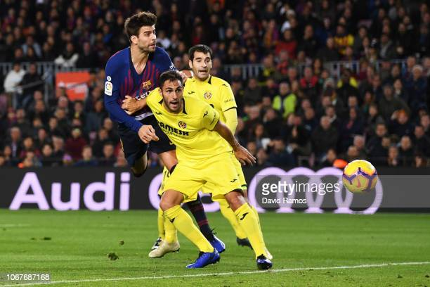Gerard Pique of Barcelona scores his team's first goal during the La Liga match between FC Barcelona and Villarreal CF at Camp Nou on December 2 2018...