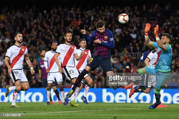 Gerard Pique of Barcelona scores his team's first goal during the La Liga match between FC Barcelona and Rayo Vallecano de Madrid at Camp Nou on...