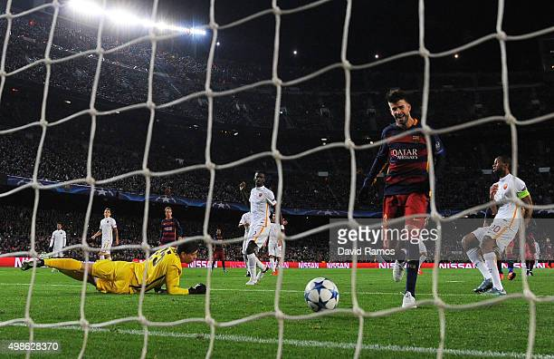 Gerard Pique of Barcelona scores his teams fourth goal during the UEFA Champions League Group E match between FC Barcelona and AS Roma at Camp Nou on...