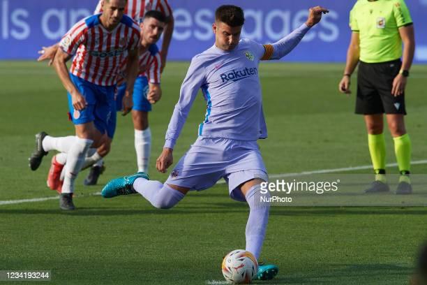 Gerard Pique of Barcelona shooting to goal during the pre-season friendly match between FC Barcelona and Girona FC at Estadi Johan Cruyff on July 24,...