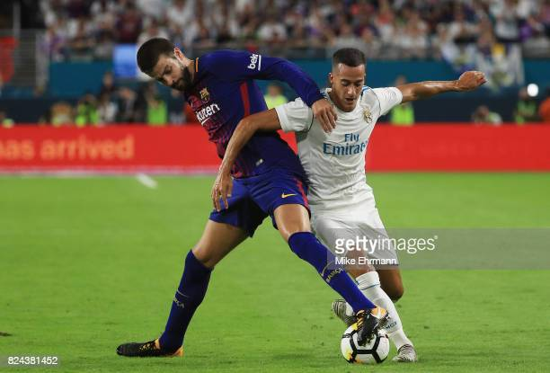 Gerard Pique of Barcelona vies for the ball with Raphael Varane of Real Madrid during their International Champions Cup 2017 match at Hard Rock...