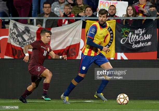 Gerard Pique of Catalonia competes for the ball with Yeferson Soteldo of Venezuela during the International Friendly match between Catalonia and...