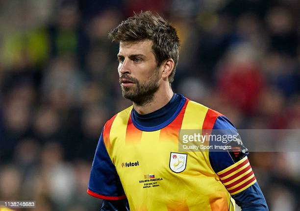 Gerard Pique of Catalonia wearing the captain armband during the International Friendly match between Catalonia and Venezuela at Montilivi Stadium on...
