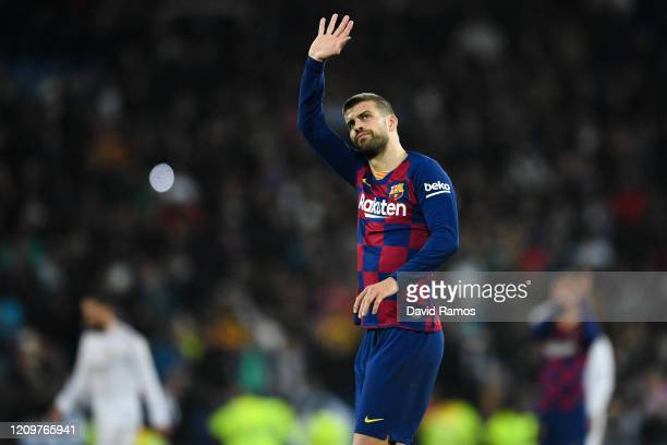 Gerard Pique of FC Barcelona acknowledges at the end of the Liga match between Real Madrid CF and FC Barcelona at Estadio Santiago Bernabeu on March...