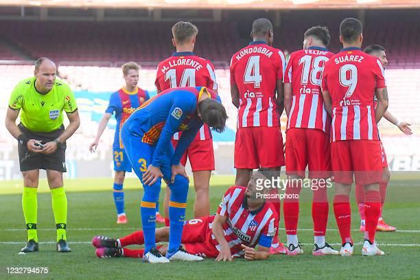 Gerard Pique of FC Barcelona and Koke Resurreccion of Atletico de Madrid during the La Liga match between FC Barcelona and Atletico de Madrid played...