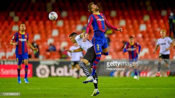Gerard Pique of FC Barcelona and Maxi Gomez of Valencia CF during the La Liga match between Valencia CF and FC Barcelona played at Mestalla Stadium...