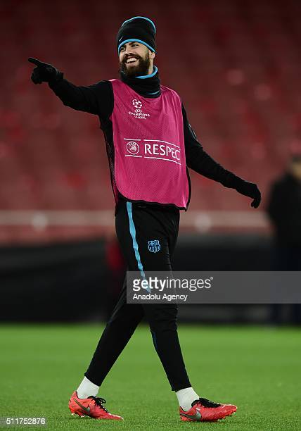 Gerard Pique of FC Barcelona attends a training session prior to the Champions League round of 16 first leg soccer match between Arsenal and...