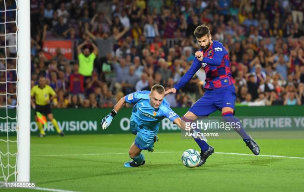Gerard Pique of FC Barcelona beats Jasper Cillessen of Valencia as he scores his team's third goal during the Liga match between FC Barcelona and...