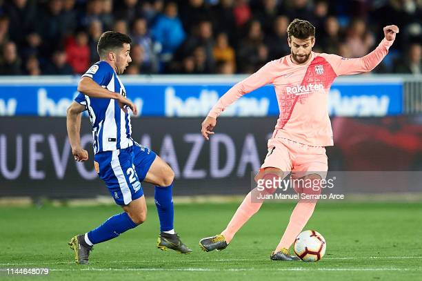 Gerard Pique of FC Barcelona being followed by Jonathan Rodriguez of Deportivo Alaves during the La Liga match between Deportivo Alaves and FC...