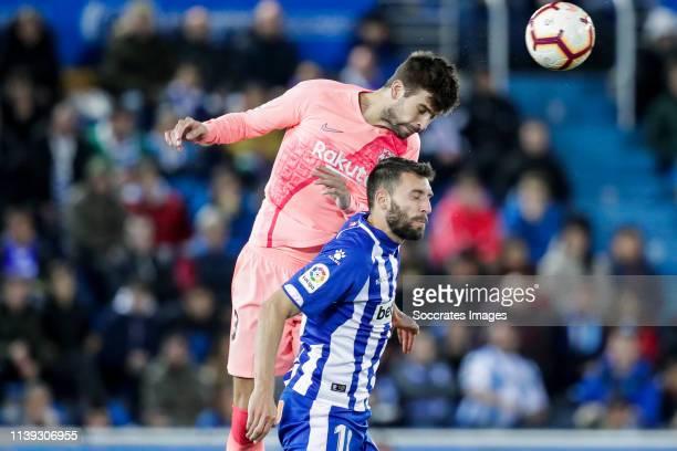 Gerard Pique of FC Barcelona Borja Baston of Deportivo Alaves during the La Liga Santander match between Deportivo Alaves v FC Barcelona at the...