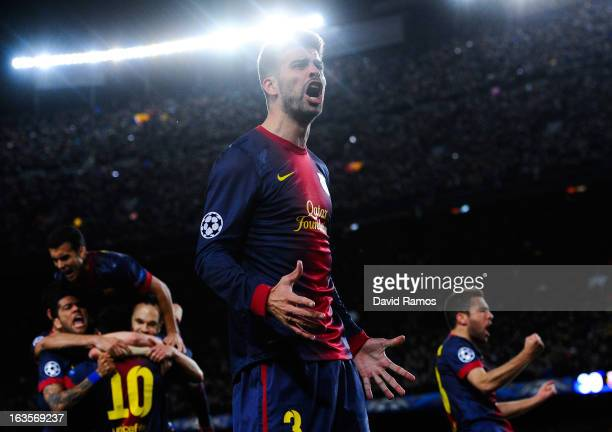 Gerard Pique of FC Barcelona celebrates after Lionel Messi of FC Barcelona after scored his team's second goal during the UEFA Champions League round...