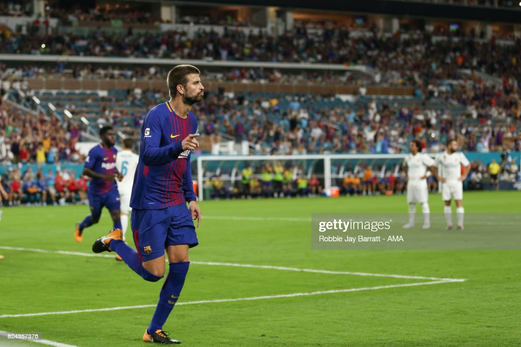 Gerard Pique of FC Barcelona celebrates after scoring a goal to make it 2-3 during the International Champions Cup 2017 match between Real Madrid and FC Barcelona at Hard Rock Stadium on July 29, 2017 in Miami Gardens, Florida.