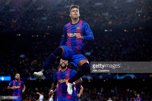 Gerard Pique of FC Barcelona celebrates after scoring his team's first goal during the UEFA Champions League group E match between FC Barcelona and...