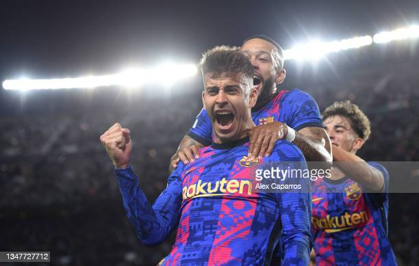 Gerard Pique of FC Barcelona celebrates after scoring their team's first goal during the UEFA Champions League group E match between FC Barcelona and...