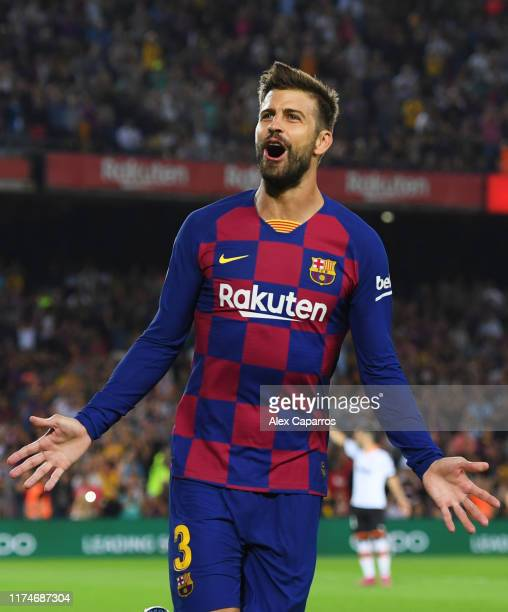 Gerard Pique of FC Barcelona celebrates as he scores his team's third goal during the Liga match between FC Barcelona and Valencia CF at Camp Nou on...