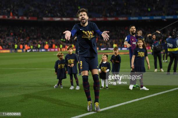 Gerard Pique of FC Barcelona celebrates as his team win the La Liga following their victory in the La Liga match between FC Barcelona and Levante UD...