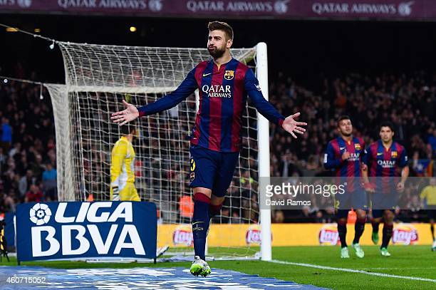 Gerard Pique of FC Barcelona celebrates scoring his team's third goal during the La Liga match between FC Barcelona and Cordoba CF at Camp Nou on...