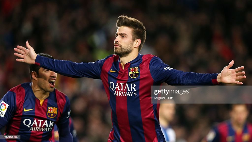 Gerard Pique of FC Barcelona celebrates the third goal during the la Liga match between FC Barcelona and RCD Espanyol at Camp Nou on December 7, 2014 in Barcelona, Spain.