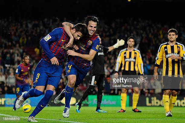 Gerard Pique of FC Barcelona celebrates with his teammate Cesc Fabregas of FC Barcelona after scoring the opening goal during the la Liga Match...