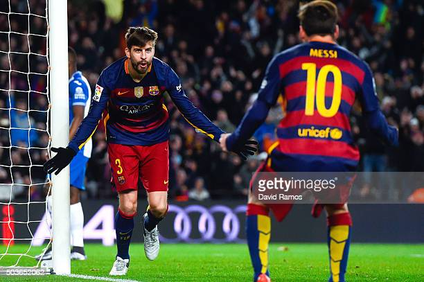 Gerard Pique of FC Barcelona celebrates with his teammate Lionel Messi of FC Barcelona after scoring his team's third goal during the Copa del Rey...