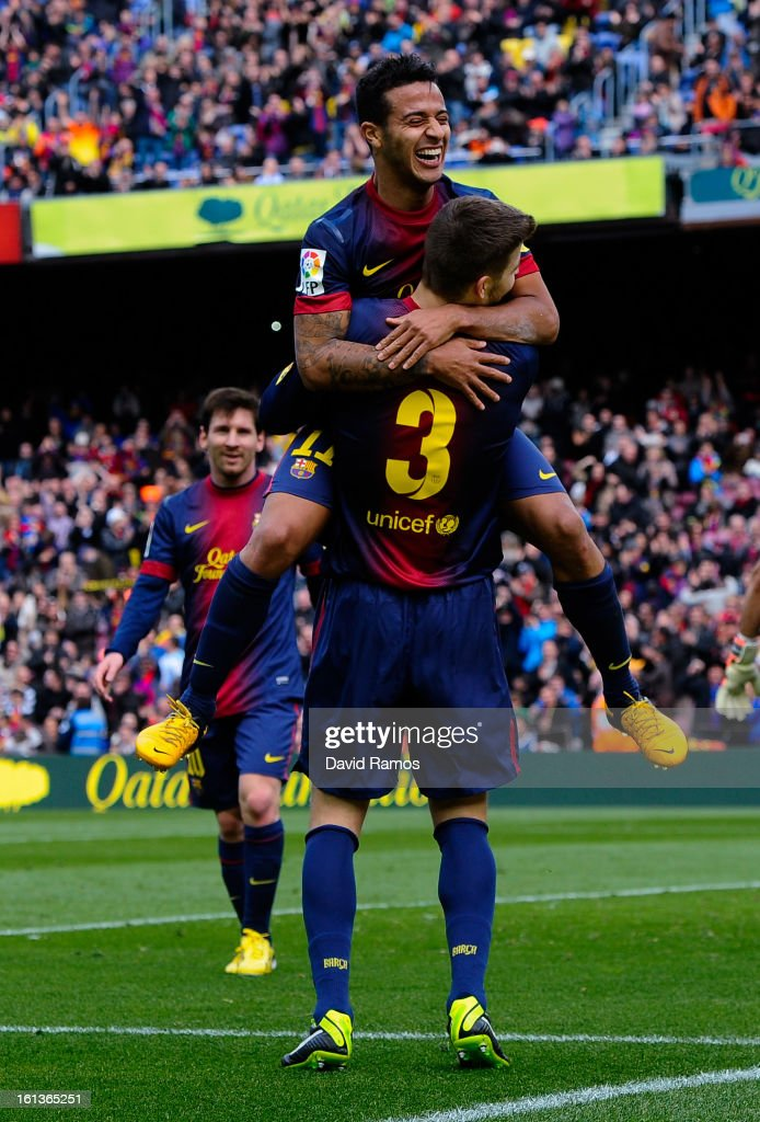 Gerard Pique (#3) of FC Barcelona celebrates with his teammate Thiago Alcantara after scoring his team's sixth goal during the La Liga match between FC Barcelona and Getafe CF at Camp Nou on February 10, 2013 in Barcelona, Spain.