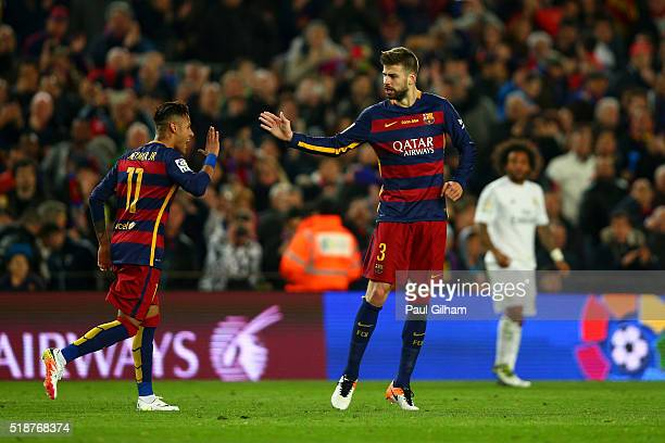 Gerard Pique of FC Barcelona celebrates with teammate Neymar after scoring the opening goal during the La Liga match between FC Barcelona and Real...