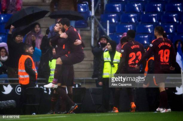 Gerard Pique of FC Barcelona celebrates with teammates after scoring his team's first goal during the La Liga match between Espanyol and Barcelona at...