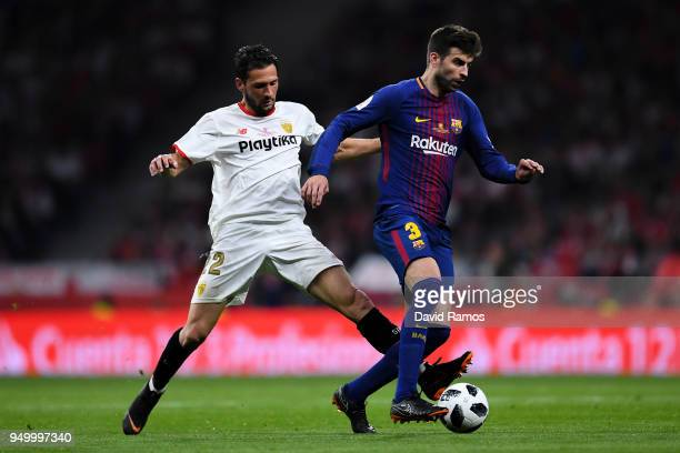 Gerard Pique of FC Barcelona competes for the ball with Franco Vazquez of Sevilla FC during the Spanish Copa del Rey Final match between Barcelona...