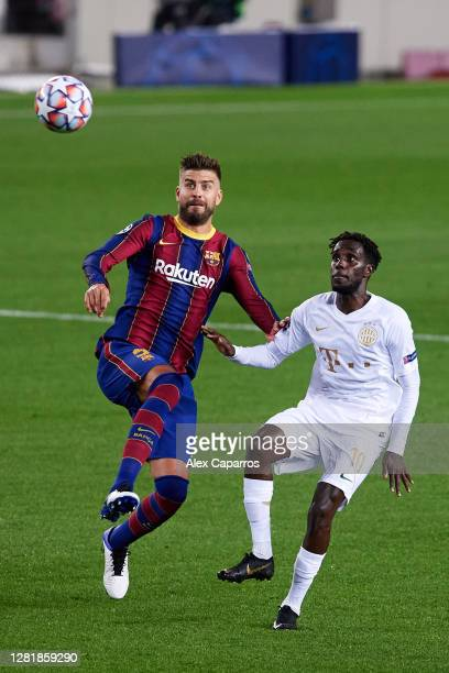Gerard Pique of FC Barcelona competes for the ball with Tokmac Nguen of Ferencvaros Budapest during the UEFA Champions League Group G stage match...