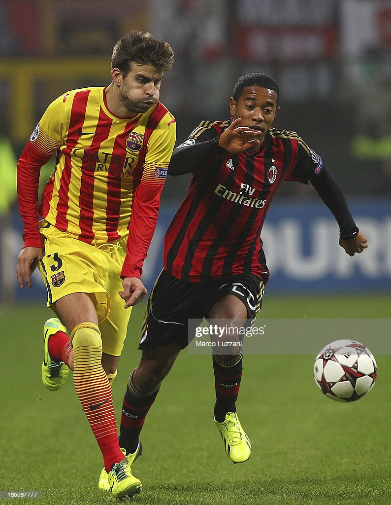 Gerard Pique of FC Barcelona competes for the ball with Urby Emanuelson of AC Milan during the UEFA Champions League Group H match between AC Milan and FC Barcelona at Stadio Giuseppe Meazza on October 22, 2013 in Milan, Italy.