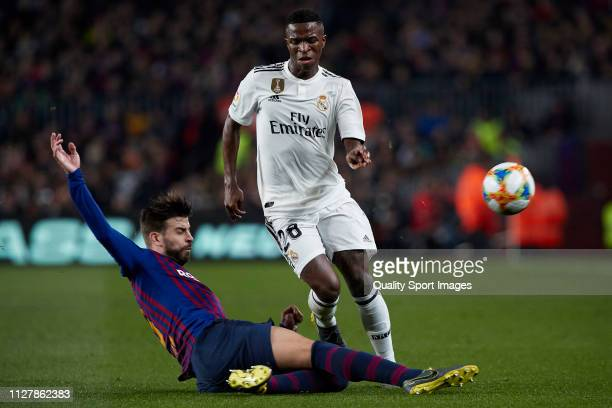 Gerard Pique of FC Barcelona competes for the ball with Vinicius Junior of Real Madrid during the Copa del Rey Semi Final first leg match between FC...