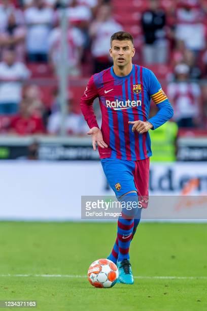 Gerard Pique of FC Barcelona controls the Ball during the Pre-Season Friendly match between VfB Stuttgart and FC Barcelona at Mercedes-Benz Arena on...
