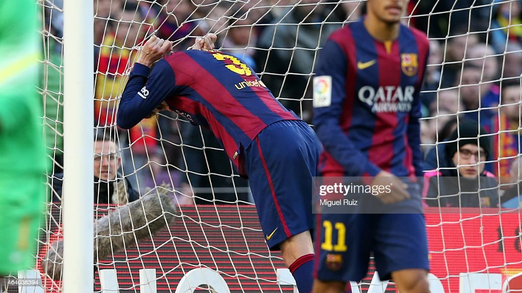 Gerard Pique of FC Barcelona despairs after missing an opportunity to score during the La Liga match between FC Barcelona and Malaga CF at Camp Nou on February 21, 2015 in Barcelona, Spain.