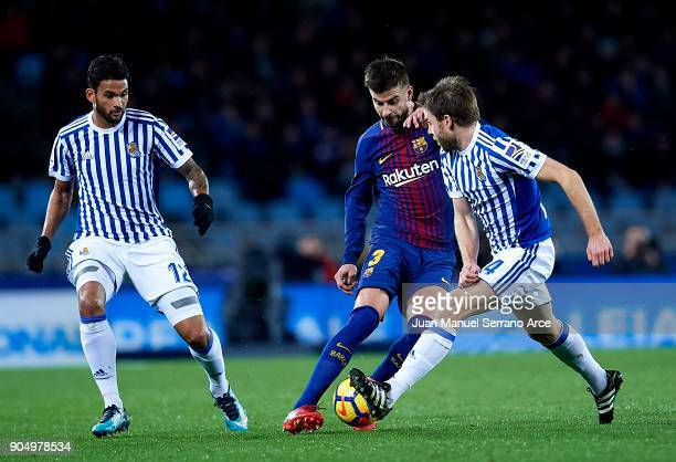 Gerard Pique of FC Barcelona duels for the ball with Asier Illarramendi of Real Sociedad during the La Liga match between Real Sociedad and FC...