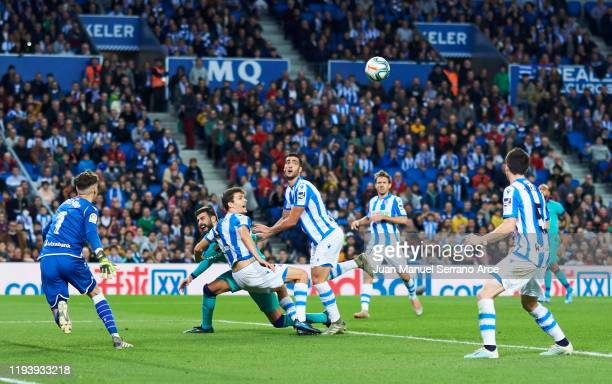 Gerard Pique of FC Barcelona duels for the ball with Diego Llorente of Real Sociedad during the Liga match between Real Sociedad and FC Barcelona at...