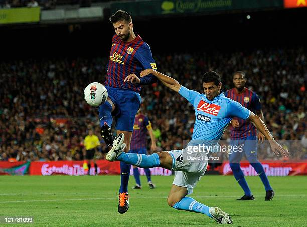 Gerard Pique of FC Barcelona duels for the ball with Miguel Britos of SSC Napoli during the Joan Gamper Trophy match between FC Barcelona and SSC...