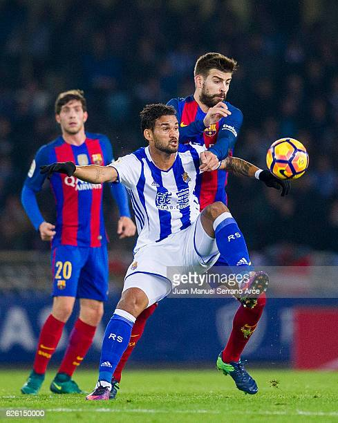Gerard Pique of FC Barcelona duels for the ball with Willian Jose Da Silva of Real Sociedad during the La Liga match between Real Sociedad de Futbol...