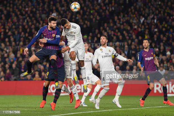 Gerard Pique of FC Barcelona fights for a high ball with Raphael Varane of Real Madrid CF during the Copa del Semi Final first leg match between...