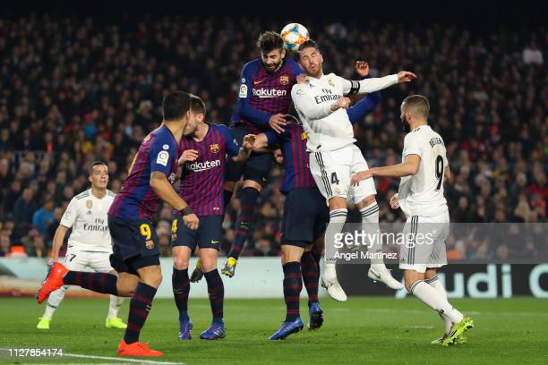 Gerard Pique of FC Barcelona fights for a high ball with Sergio Ramos of Real Madrid CF during the Copa del Semi Final first leg match between...