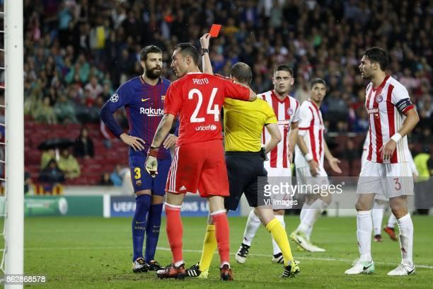 Gerard Pique of FC Barcelona, goalkeeper Silvio Proto of Olympiacos, referee William Collum, Sasa Zdjelar of Olympiacos, Alberto Botia of Olympiacos...